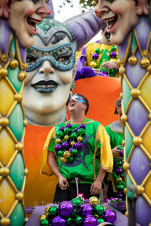 Krewe of Freret member Josh Fogarty shouts as the krewe parades through uptown New Orleans. The Krewe paraded for more than 40 years until the mid-1990s. In 2011, they reorganized and created a unique parade favoring local vendors and craftspeople. Members also hand-decorate Mardi Gras Masks as coveted signature throws.
