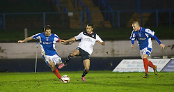 Cowdenbeath's John Armstrong and Falkirk's Phil Roberts.<br /> Cowdenbeath 0 v 2 Falkirk, Scottish Championship game today at Central Park, the home ground of Cowdenbeath Football Club.<br /> © Michael Schofield.