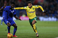 Josh Murphy of Norwich city goes past Bruno Ecuele Manga of Cardiff city (l). EFL Skybet championship match, Cardiff city v Norwich city at the Cardiff city stadium in Cardiff, South Wales on Friday 1st December 2017.<br /> pic by Andrew Orchard, Andrew Orchard sports photography.