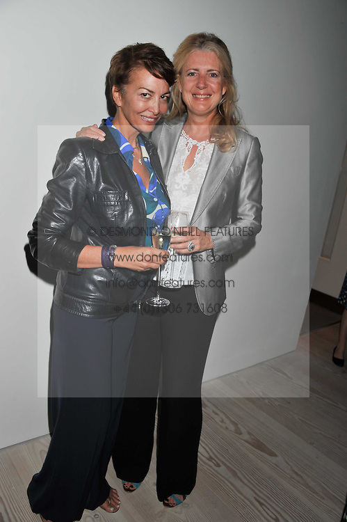 Left to right, KARI LARDISSONE and MARIE CLARE AGNEW at a fundraising party hosted by the Kensington and Chelsea Foundation at The Saatchi Gallery, Kings Road, London on 27th September 2011.