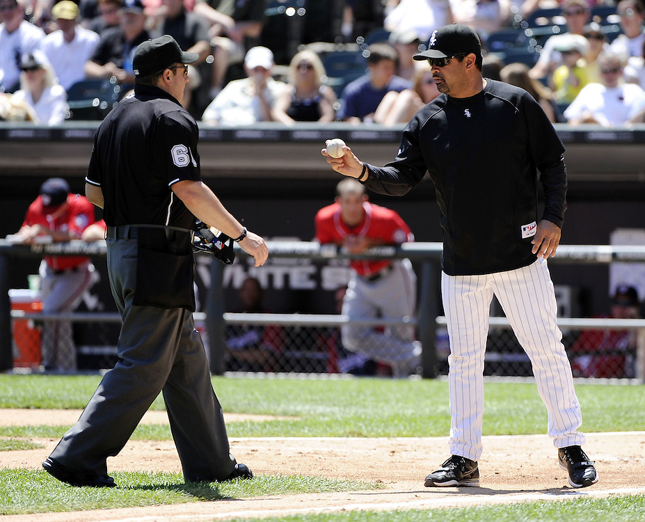 CHICAGO, IL - JUNE 26:  Manager Ozzie Guillen #13 of the Chicago White Sox points to the baseball while discussing a hit by pitch call on Roger Bernadina #2 of the Washington Nationals by home plate umpire Marty Foster #60 during the fourth inning on June 26, 2011 at U.S. Cellular Field in Chicago, Illinois.  The Nationals defeated the White Sox 2-1.  (Photo by Ron Vesely/MLB Photos via Getty Images)  *** Local Caption *** Ozzie Guillen;Roger Bernadina;Marty Foster