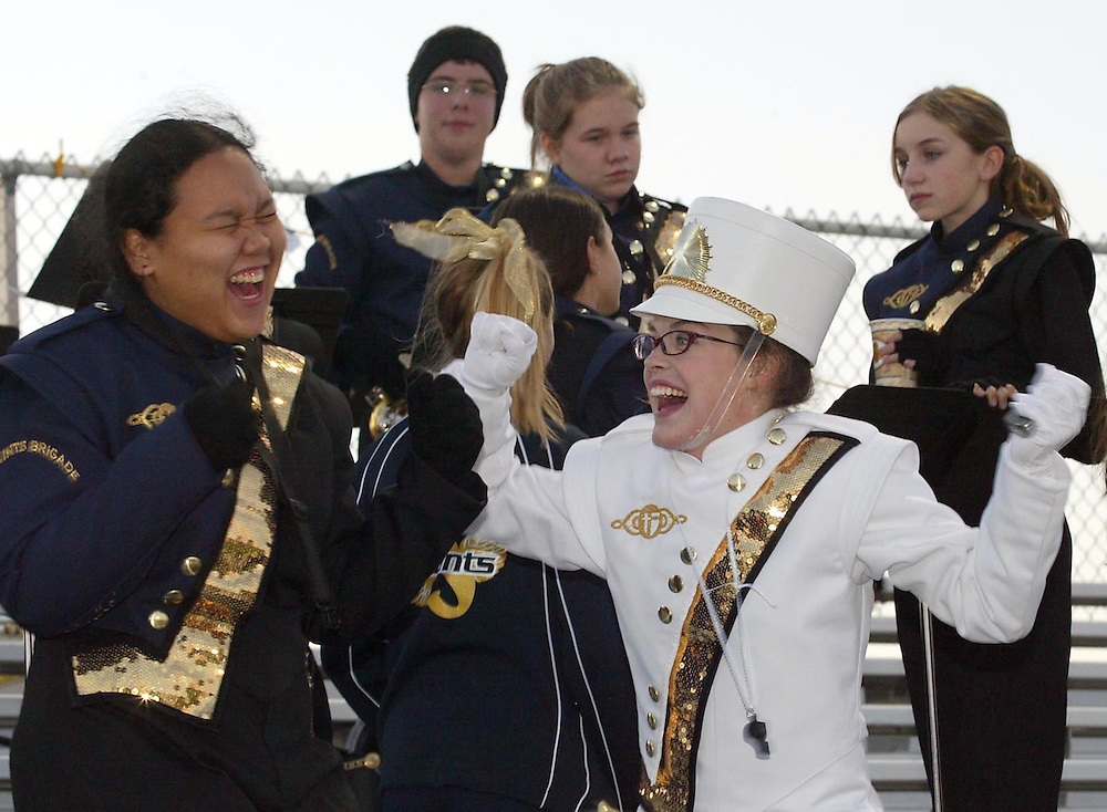 Singing, dancing and goofing around are all part of marching band at Saint Thomas Aquinas. Junior saxophonist Alex Sabido and senior drum major Aleah McGehee made the most of their pre-game time in the stands Friday night.