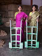 Coffee plantation workers with sack barrows, Malabar, Kerala, India