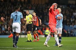 Shakhtar Donetsk goalkeepr Andriy Pyatov (centre) reacts to penalty kick being given during the game