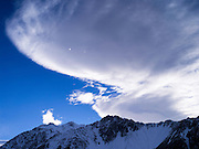 Lenticular clouds form during the morning over Aoraki/Mt. Cook National Park, New Zealand.