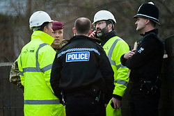 The Armies Royal Logistics Corps, Bomb Disposal Team were called in and police closed  Leppings lane behind Sheffield Wednesday Football Ground on Tuesday after Council workers carrying out clearance work on the Banks of the River Don discovered what they thought might be an unexploded WWII bomb. A member of the Team breaks the news to Police and Council officials that it was a false alarm <br /> 5 March  2013<br /> Image © Paul David Drabble