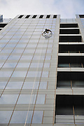 Window washer on side of skyscraper