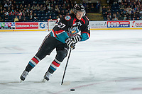 KELOWNA, CANADA, OCTOBER 16 -  Ryan Olsen #27 of the Kelowna Rockets skates with the puck against the Lethbridge Hurricanes on Wednesday, October 16, 2013 at Prospera Place in Kelowna, British Columbia (photo by Marissa Baecker/Getty Images)***Local Caption***