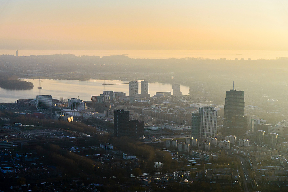 Nederland, Flevoland, Almere, 14-02-2017;  Almere-Stad, winters stadsgezicht, stadshart bij zinsondergang. Weerwater in de achtergrond<br /> Almere City, winter cityscape, city heart.<br />  <br /> luchtfoto (toeslag op standard tarieven);<br /> aerial photo (additional fee required);<br /> copyright foto/photo Siebe Swart