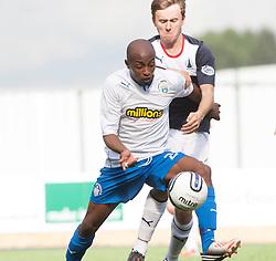 Morton's Fouad Bachirou and Falkirk's Thomas Grant.<br /> Falkirk 3 v 0 Morton, Scottish Championship 17/8/2013.<br /> ©Michael Schofield.