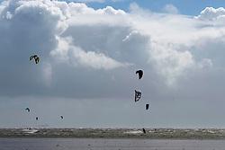 © Licensed to London News Pictures. 22/08/2020. Pembrey sands, Carmarthenshire, Wales, UK. Kite surfer enjoy the strong winds at Pembrey Sands in Carmarthenshire, Walse, UK.. Photo credit: Graham M. Lawrence/LNP