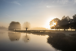 © Licensed to London News Pictures. 30/10/2017. London, UK. Sunrise in Bushy Park where plummeting overnight temperatures caused the first frost of the winter season. Photo credit: Rob Pinney/LNP