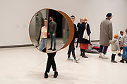 Visitors interacting with artworks at the Space Shifters exhibition at the Hayward Gallery on 16th December 2018 in London, United Kingdom. The exhibit was a major group show of sculptures and installations that explored perception and space, featuring 20 artists. Interactive Abstract Bodies Split Ellipse, 2012 by Josiah McElheny.
