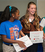 Hava Schultz, right, is named the Youth Volunteer of the Year during Volunteers in Public Schools recognition ceremony, May 14, 2015.