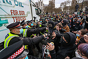 Police scuffles and argue with demonstrators during clashes following a 'Kill the Bill' protest outside the Houses of Parliament in London on Saturday, April 3, 2021. Projectiles were thrown as police pushed protesters away, and dozens of extra officers were brought in to help unblock the road for a McDonald's lorry held up outside parliament. (Photo/ Vudi Xhymshiti)