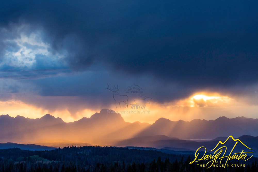 """Stormy Sunset, Grand Tetons from the Bridger Teton National Forest at Togwotee Pass. I was hoping for lightning; however, I wasn't disappointed.<br /> <br /> For production prints or stock photos click the Purchase Print/License Photo Button in upper Right; for Fine Art """"Custom Prints"""" contact Daryl - 208-709-3250 or dh@greater-yellowstone.com"""