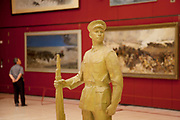 Exhibition of Chinese revolutionary art. The National Museum of China flanks the eastern side of Tiananmen Square in Beijing, China. The mission of the museum is to educate about the arts and history of China. It is directed by the Ministry of Culture of the People's Republic of China. The museum was established in 2003 by the merging of the two separate museums that had occupied the same building since 1959. The building was completed in 1959 as one of the Ten Great Buildings celebrating the ten-year anniversary of the founding of the People's Republic of China. After four years of renovation, the museum reopened on March 2011 with 28 new exhibition halls, more than triple the previous exhibition space, and state of the art exhibition and storage facilities. It has a total floor space of nearly 200,000 square meters to display. The renovations were designed by the German firm Gerkan, Marg and Partners.