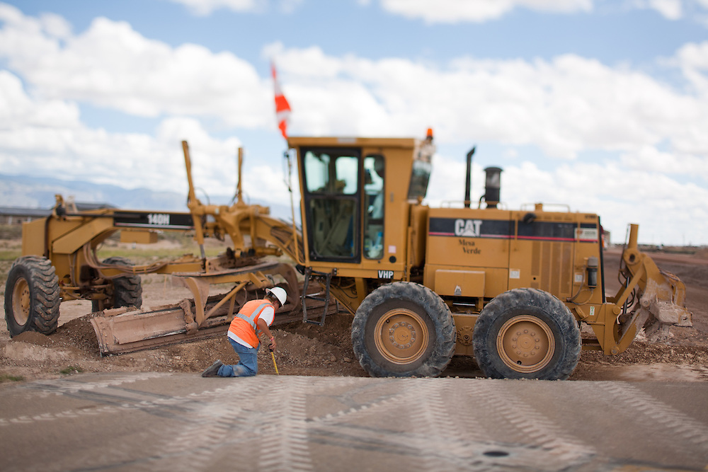 A worker takes a measurement at work building new runways at Holloman Air Force Base in Otero County. HAFB received over $21 million to upgrade various facilities as part of the Recovery and Reinvestment Act.