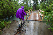 Flooded bridge at Jacques Lake Trailhead, Jasper National Park, Canadian Rockies, Alberta, Canada. With 1km of rerouting discouraging our bikes on flooded Jacques Lake Trail on 01 July 2019, we instead hiked on foot for 6 miles to scenic Beaver Lake, then nearly to Summit Lake before turned back by rain, in Jasper National Park, Canadian Rockies, Alberta, Canada. We'll gladly return on a sunny day to re-experience this scenic trail. Jasper is the largest national park in the Canadian Rocky Mountain Parks World Heritage Site, honored by UNESCO in 1984.