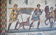 Close up detail picture of the Roman mosaics of the small hunt depicting a dead boar being carried by hunters, room no 24 at the Villa Romana del Casale, first quarter of the 4th century AD. Sicily, Italy. A UNESCO World Heritage Site.<br /> <br /> The Small Hunt room was used as a living room for guests of the Villa Romana del Casale. The Small hunt mosaic design has 4 registers running across the mosaic depicting hunting scenes. In the first register two servants are handling hunting dogs. In the second register figures are depicted burning incense at an altar to Diana, the goddess of hunting, before the hunt starts. The offering is being made by Constantius Clorus , the Caesar of Emperor Maximianus who owned the Villa Romana del Casale. Behind him is his son the future Emperor Constantine. To the right of the altar is a figure holding the reins of a horse dressed in a clavi decorated with ivy leaves indicating that he belongs to the family of Maximianus. .<br /> <br /> If you prefer to buy from our ALAMY PHOTO LIBRARY  Collection visit : https://www.alamy.com/portfolio/paul-williams-funkystock/villaromanadelcasale.html<br /> Visit our ROMAN MOSAICS  PHOTO COLLECTIONS for more photos to buy as buy as wall art prints https://funkystock.photoshelter.com/gallery/Roman-Mosaics-Roman-Mosaic-Pictures-Photos-and-Images-Fotos/G00008dLtP71H_yc/C0000q_tZnliJD08