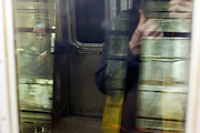 glass reflection with passenger New York subway