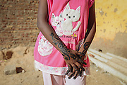 A young girl for her Henna to dry, Seheil Island