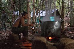 El Diamante, Meta, Colombia - 16.09.2016        <br /> <br /> Kitchen area of the guerilla camp during the 10th conference of the marxist FARC-EP in El Diamante, a Guerilla controlled area in the Colombian district Meta. Few days ahead of the peace contract passing after 52 years of war with the Colombian Governement wants the FARC decide on the 7-days long conferce their transformation into a unarmed political organization. <br /> <br /> Kueche des Guerilla-Camps zur zehnten Konferenz der marxistischen FARC-EP in El Diamante, einem von der Guerilla kontrollierten Gebiet im kolumbianischen Region Meta. Wenige Tage vor der geplanten Verabschiedung eines Friedensvertrags nach 52 Jahren Krieg mit der kolumbianischen Regierung will die FARC auf ihrer sieben taegigen Konferenz die Umwandlung in eine unbewaffneten politischen Organisation beschlieflen. <br />  <br /> Photo: Bjoern Kietzmann