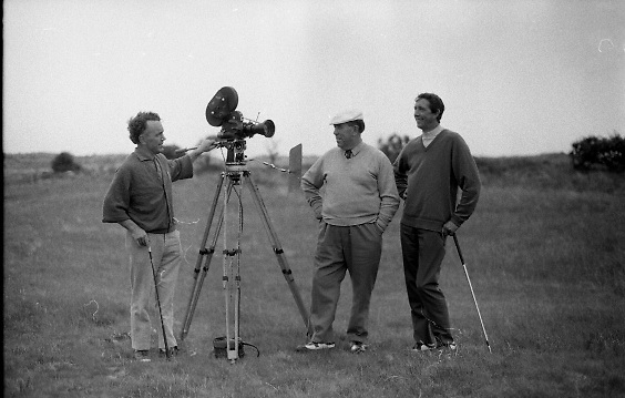 Golf Being Filmed at Portmarnock - Special for Bord Failte<br /> 1970.<br /> 27.05.1970.<br /> 05.27.1970.<br /> 27th May 1970.<br /> As part of a promotion to encourage golfers from around the world to come to Ireland to play on some of our many world class courses, Bord Failte promoted the making of a film showing golfers playing at Portmarnock Co Dublin. Two of Ireland,s best known golfers,Joe Carr and Harry Bradshaw, agreed to feature in the making of the film.<br /> <br /> Images show some of the golfers and film crew who took part in the making of the film.