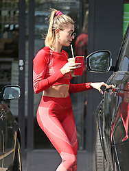 Hailey Bieber all in red stops for juice after gym session. 24 Feb 2020 Pictured: Hailey Bieber. Photo credit: ENEWS/MEGA TheMegaAgency.com +1 888 505 6342