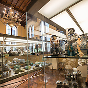 Ornate china, pottery, silver, and crockery on display at the Museum of the City of Brussels. The museum is dedicated to the history and folklore of the town of Brussels, its development from its beginnings to today, which it presents through paintings, sculptures, tapistries, engravings, photos and models.