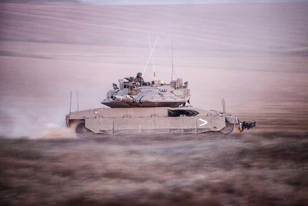 An Israeli tank is on the move near the northern Gaza Strip.<br />  Israeli leadership has decided to conduct a military operation against Hamas and other Palestinian militant group after a few days os escalation ,in which dozens of rockets were fired from The Gaza Strip to several cities in southern Israel. The IDF civil command has prohibited gatherings of 300 people or more in the area and gave the order to open public bomb shelters.