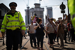© Licensed to London News Pictures . 19/05/2018. Manchester, UK. Stand Up to Racism counter-protest against the FLA marches through Manchester City Centre . The Football Lads Alliance demonstrate in Manchester , three days before the first anniversary of the Manchester Arena terror attack . Photo credit: Joel Goodman/LNP