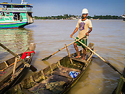 17 JUNE 2013 - YANGON, MYANMAR:  A small canoe in a large Yangon fish market. The market serves both domestic retail customers and wholesale international customers. With thousands of miles of riverine waterways and ocean coastline Myanmar has a large seafood and fishing industry.     PHOTO BY JACK KURTZ