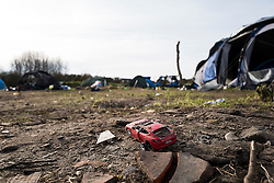 © London News Pictures. Calais, France. 18/01/16. An abandoned toy car in a section of the Calais 'Jungle' camp which has been evicted. French authorities are clearing a 100-metre 'buffer zone' between the camp and the adjacent motorway, which leads to the ferry port.  Photo credit: Rob Pinney/LNP