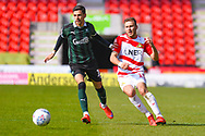 Herbie Kane of Doncaster Rovers (15) and Ruben Lameiras of Plymouth Argyle (11) in action during the EFL Sky Bet League 1 match between Doncaster Rovers and Plymouth Argyle at the Keepmoat Stadium, Doncaster, England on 13 April 2019.