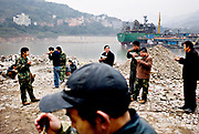 workers at dong Feng ship tard having lunch along the yanngtze river in Chongqing, China, on monday 21. jan, 2008