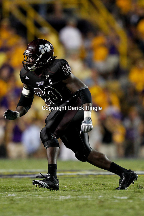 Sep 18, 2010; Baton Rouge, LA, USA; Mississippi State Bulldogs defensive tackle Pernell McPhee (90) rushes the LSU Tigers quarterback during the second half at Tiger Stadium. The LSU Tigers defeated the Mississippi State Bulldogs 29-7. Mandatory Credit: Derick E. Hingle