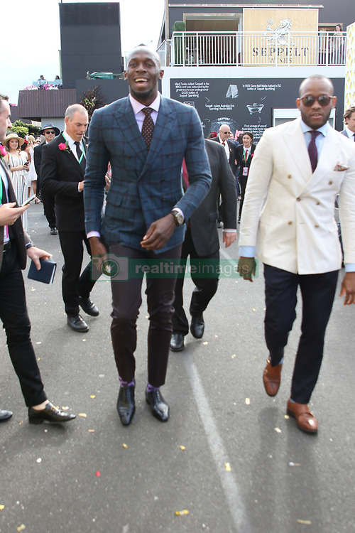 Sprinter Usain Bolt was mobbed and asked for photos when he entered the Birdcage area at Kennedy Oaks Day. Even a female security guard managed to get a photo with him before he escaped into the Mumm's marquee. 08 Nov 2018 Pictured: Usain Bolt. Photo credit: Richard Milnes / MEGA TheMegaAgency.com +1 888 505 6342
