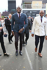 Usain Bolt gets mobbed as he enters the Birdcage area at Oaks Day - 08 Nov 2018
