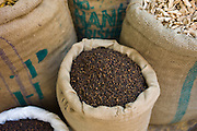 Sacks of dried cloves and ginger at Khari Baoli Spice and Dried Foods Market in Old Delhi, India