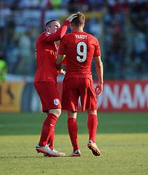 Wayne Rooney of England (Manchester United) checks on the welfare of Jamie Vardy of England (Leicester City)  - Mandatory byline: Joe Meredith/JMP - 07966386802 - 05/09/2015 - FOOTBALL- INTERNATIONAL - San Marino Stadium - Serravalle - San Marino v England - UEFA EURO Qualifers Group Stage