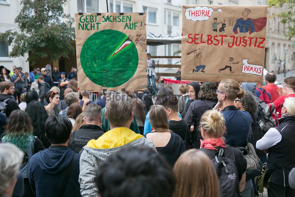 """Berlin, Germany - 31.08.2018<br /> <br /> About 1000 people take part in the civil society rally """"Saxony! Stop the mob!"""" rally in front of the Saxon state representation in Berlin. A counter-demonstrator positioned himself on the edge of the rally. Background of the rally were especially the occurrences in Chemnitz, where thousands of right-wing radicals marched through the city after the death of a 35-year-old man. Hitler salutes were shown, xenophobic slogans chanted and people get attacked.<br /> <br /> Etwa 1000 Menschen beteiligen sich an der zivilgesellschaftlichen """"Sachsen! Stopp den Mob!""""-Kundgebung vor der saechsichen Landesvertretung in Berlin. Am Rande der Kundgebung positionierte sich auch ein Gegendemonstrant. Hintergrund der Kundgebung waren insbesondere die Ereignisse in Chemnitz, dort zogen tausende Rechtsradikale nach dem Tod eines 35-jaehrigen durch die Stadt. Hitlergruesse wurden gezeigt, fremdenfeindliche Parolen skandiert und Menschen attackiert.<br />   <br /> Photo: Bjoern Kietzmann"""
