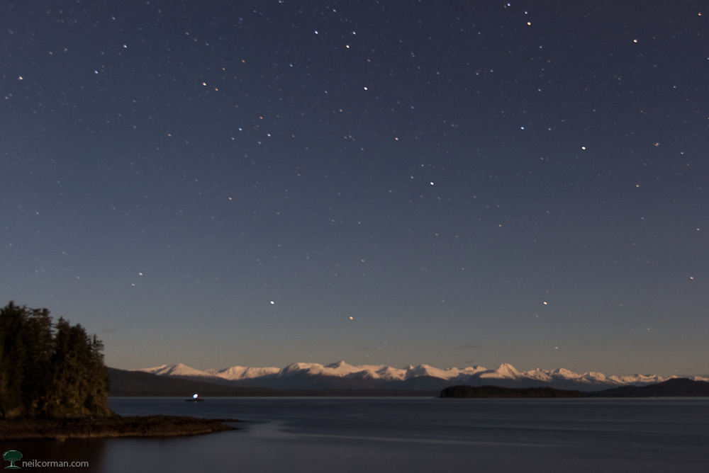 On a November evening I headed to North Douglas and a vantage point that I knew you could see the Chilkat Range in the distance. Once again under a moonlight evening I used a long exposure to capture the scene. The stars you see in this image do not do it justice for what I saw just a 15 minute drive from downtown Juneau.  From this vantage point the mountains are the boundary between the Lynn Canal and Glacier Bay National Park and Preserve.