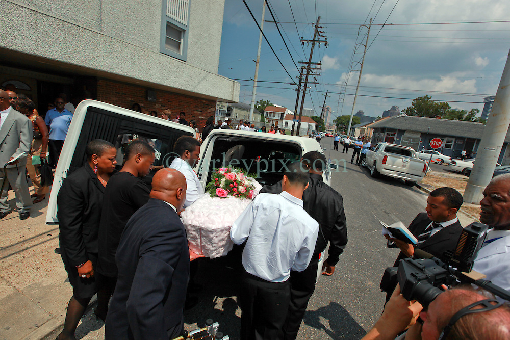 07 September 2013. New Hope Baptist Church. New Orleans, Louisiana. <br /> Pall bearers with the small coffin of 1 year old toddler Londyn Unique Reed Samuels, shot to death August 29th.  The infant Londyn was shot by thugs whilst in the arms of her babysitter, the intended victim who was holding Londyn whilst walking down the street at the time of the assault. NOPD has arrested 2 men in connection with the heinous crime.<br /> Photo; Charlie Varley