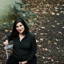 Nassira El Moadem, journalist and writer, posing in her editor's garden. Paris, France. October 22, 2019.<br /> Nassira El Moadem, journaliste et ecrivaine, posant dans le jardin de son editeur. Paris, France. 22 octobre 2019.