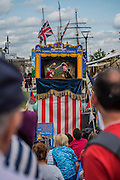 Punch and Judy to entertains the kids - Royal Greenwich Tall Ships Festival with a fleet of square rigged ships moored on the Thames at Greenwich and Woolwich. The fleet includes two of the biggest Class A Tall Ships - the Dar Mlodziezy and Santa Maria Manuela - which are moored on Tall Ships Island in the river off Greenwich. Tall Ships Festival Day on Saturday 29 August featured free family entertainment and the chance to enjoy a taste of life on the high seas.