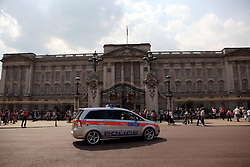 21 April 2011. London, England..Armed police patrols outside Buckingham Palace amid tight security in the run up to Catherine Middleton's marriage to Prince William..Photo; Charlie Varley.