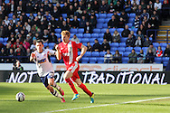 Bolton's Mark Davies is challenged by Blackburns Chris Taylor. Skybet championship match, Bolton Wanderers v Blackburn Rovers at the Reebok Stadium in Bolton, England on Saturday 1st March 2014.<br /> pic by David Richards, Andrew Orchard sports photography.
