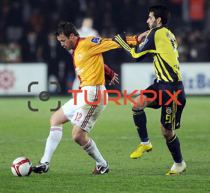 Galatasaray's Lucas NEILL (L) and Fenerbahce's Daniel Gonzalez GUIZA (R) during their Turkish superleague soccer derby match Galatasaray between Fenerbahce at the AliSamiYen Stadium at Mecidiyekoy in Istanbul Turkey on Sunday, 28 March 2010. Photo by TURKPIX