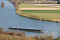 Romanian cargo ship travels north on the Danube river near Regensburg, Germany